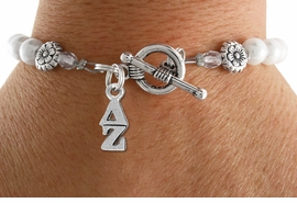 <Br>OFFICIALLY LICENSED SORORITY BRACELET!!<Br>                     LEAD & NICKEL FREE!!<Br>               W18782B - DELTA ZETA  <BR>                   PEARL BEAD BRACELET <BR>                     FROM $9.00 TO $20.00