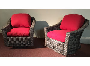 A Pair Of Grey Outdoor Swivel Glider Chairs