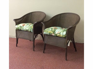 A Pair of Lloyd Flanders Dining Chairs