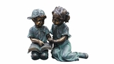 Boy and Girl Reading Together Statue by Alpine Corp