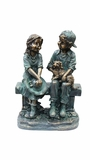 Girl and Boy Sitting on Bench with Puppy Statue by Alpine Corp