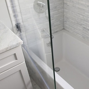 Ark Shower Screens can open up to 90 degrees into and out of the bathtub