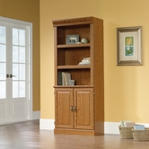 Sauder 402173 Orchard Hills Library With Doors In Carolina Oak Finish