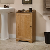 Sauder 414033 Sundial Floor Cabinet in Highland Oak Finish