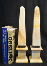 Vintage cream marble obelisks with black marble ball mounts