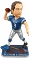 Matthew Stafford (Detroit Lions) Forever Collectibles 2014 NFL Springy Logo Base Bobblehead
