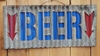 Corrugated Metal Beer with Arrow Sign