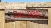 Up-cycled Corrugated Metal Saloon with Cowboy Heads Sign