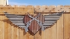 Up-cycled Corrugated Metal Wings with Cross Pistols and Heart