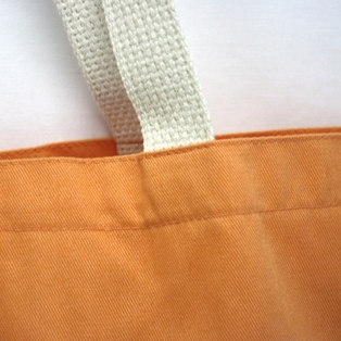 http://ep.yimg.com/ay/yhst-132146841436290/canvas-tote-bag-in-orange-4.jpg