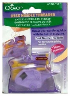 http://ep.yimg.com/ay/yhst-132146841436290/clover-desk-needle-threader-2.jpg