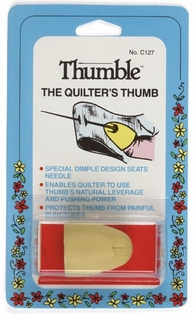 http://ep.yimg.com/ay/yhst-132146841436290/collins-thumble-the-quilter-s-thumb-2.jpg