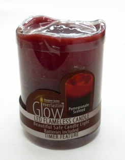 http://ep.yimg.com/ay/yhst-132146841436290/flameless-candle-4-in-pomegranate-scented-2.jpg