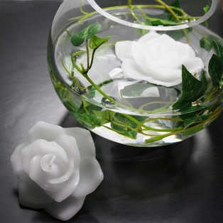 http://ep.yimg.com/ay/yhst-132146841436290/floating-rose-candles-pkg-of-12-white-2.jpg