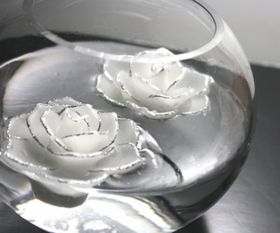 http://ep.yimg.com/ay/yhst-132146841436290/floating-rose-candles-pkg-of-12-white-silver-2.jpg