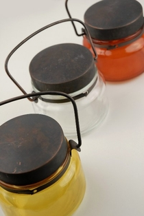 http://ep.yimg.com/ay/yhst-132146841436290/hanging-jars-glass-candle-holders-3-3-4-inch-3-color-assortment-12-jars-3.jpg
