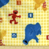 Sesame Street Character Toss Flannel Fabric - Yellow