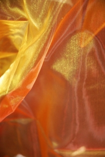 http://ep.yimg.com/ay/yhst-132146841436290/sheer-iridescence-drape-yellow-and-orange-28-inch-x-3-yds-2.jpg