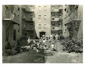 A family in their courtyard - Jackson Heights - Queens NY