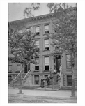 A family poses outside their building in Fort Greene Brooklyn