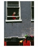 A lady in the window in a Greenwich Village 1965 Downtown Manhattan