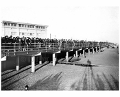 A view from the Boardwalk from the beach looking east from W. 5th street 1922
