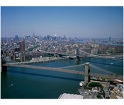 Aerial view of Manhattan, looking toward Brooklyn with Brooklyn & Manhattan bridges in view crossing the East River