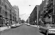 Alabama Avenue looking north to Dumont Avenue, showing P.S. 174 and synagogue, 1964