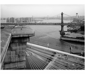 Brooklyn Bridge - View from the top of Brookltn Tower - showing man walkingup the main cable & the Manhattan bridge behind - 1982
