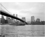 Brooklyn Bridge - view lookiong west from Brooklyn shore with ferry boat in the river 1982