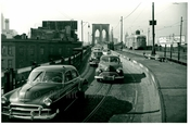 Brooklyn Bridge with cars passing over