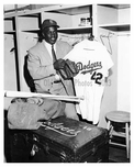 Brooklyn Dodger  Jackie Robinson retires from Baseball - seen packing up in the locker room at Ebbets Field - 1957 - Flatbush  - Brooklyn NY