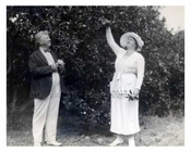 Brooklyn Dodgers Owner Fick & his wife picking oranges while the Dodgers spring training commences in Florida 1940s