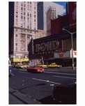 Cars rolling through Times Square in 1970s Manhattan