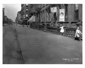 """Children playing on Lexington Avenue & 104th Street outside of a """"Hair Dressing Parlor"""" 1911 - Upper East Side, Manhattan - NYC"""
