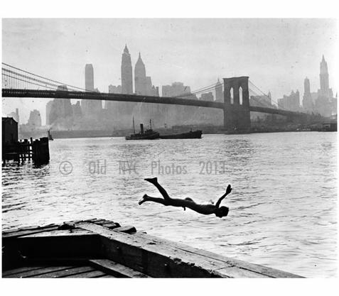 diving in head first with the Brooklyn Bridge and Manhattan Skyline in the background