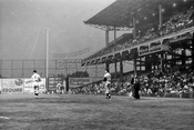 Ebbetts Field with clown Emmett Kelly at right, 1957