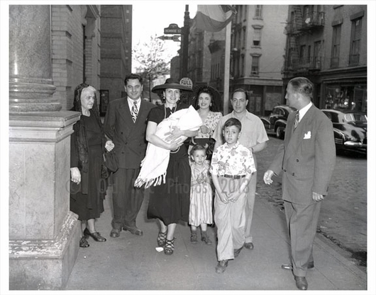 Family gathered on the corner of Monroe St.
