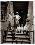 Family hanging out on the stoop of apt bldg. Brooklyn NY