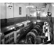 General interior view of power plant showing three generators with control panel on the left- at  Pratt Institute