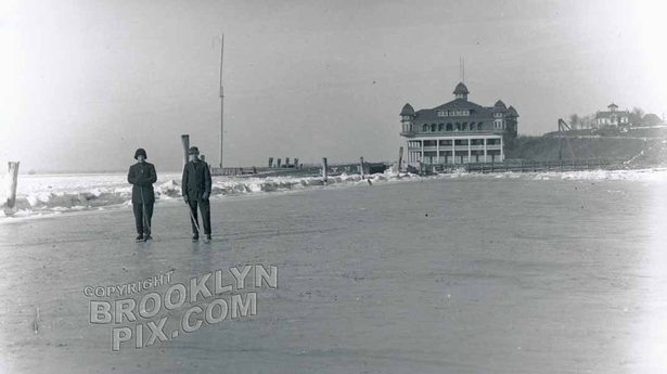 Ice hockey at foot of 82nd Street, Crescent Athletic Club in distance, 1912