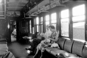 Inside a C-type wooden elevated car on the BMT Fulton Street el, c.1955