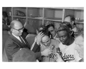 Jackie Robinson & Yogi Berra getting interviewed in the dug out after World Series Game at  Ebbets Field 1956 - Brooklyn NY