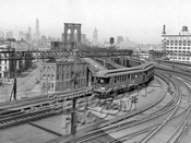 Lexington Avenue el trains approaches Sands Street station in Brooklyn, c.1941
