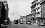 Looking west down Broadway toward the East River showing Gretsch Building, 1950