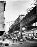 Myrtle Avenue looking east from Clinton Avenue, showing Peerless Theater, c.1969