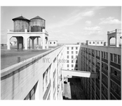 Navy Yard roofscape, looking west above railroad court, showing water tanks for sprinkler system, US Navy Fleet Supply Base