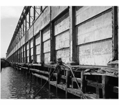 New York Barge Canal, Gowanus  Bay Terminal Pier - view of east side cargo doors and cargo mast system