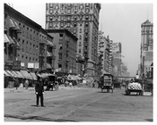 Policeman directing traffic at 7th Avenue between 33rd & 34th Streets - Chelsea NY 1915