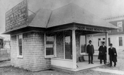 Real estate office on southeast corner Gravesend Road and East 15th Street, 1911